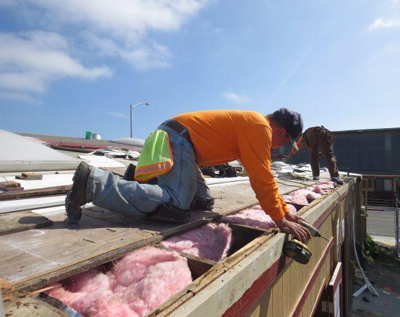 Volunteer installs cool roof