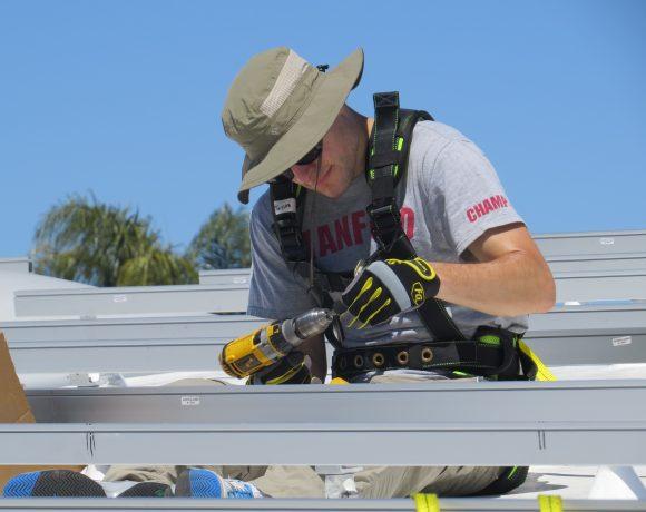 Stanford volunteer works on solar panel
