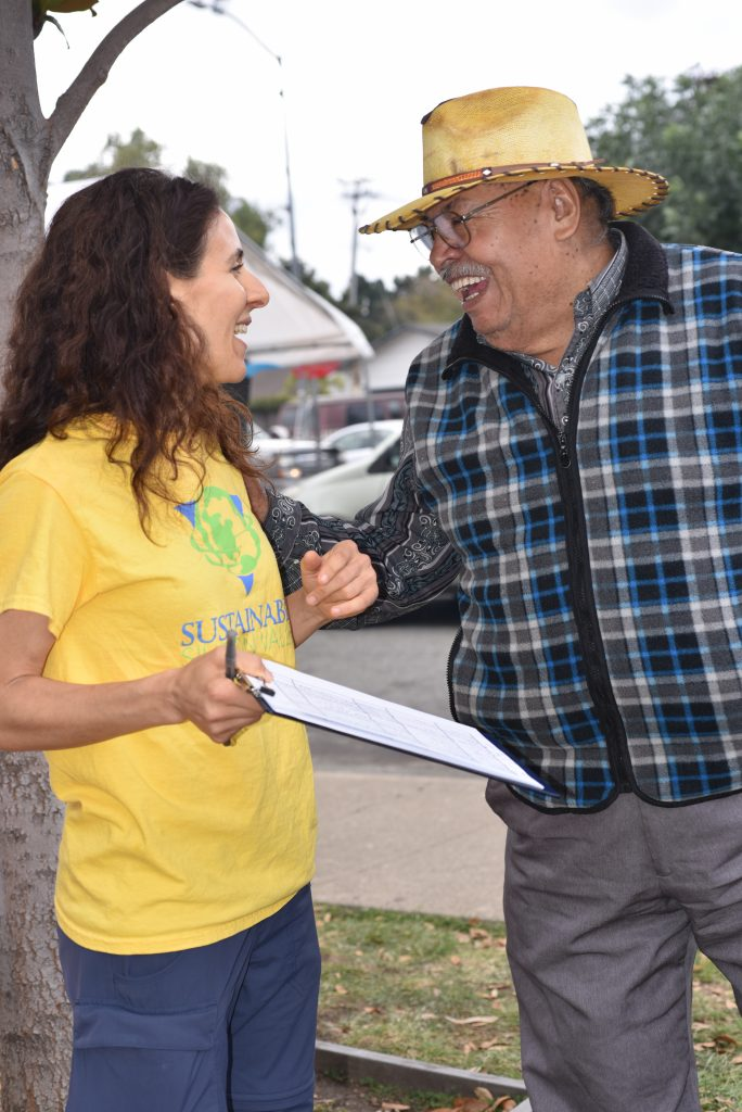 Andrea Fuchilieri signs up East Palo Alto residents for SSV's Energy and Water Check-Up Program